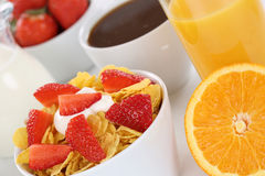 Healthy breakfast with fruit cereals, orange juice and coffee Stock Photo