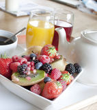 Healthy breakfast with fruit and juice. A healthy breakfast with fruit and juice, tea and coffee royalty free stock images