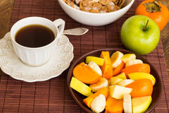 Healthy breakfast with fruit salad, granola and coffee. Royalty Free Stock Photo