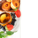 Healthy breakfast - fruit, tea and muffins Royalty Free Stock Image