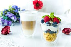 Healthy breakfast full of vitamins and probiotics. Yoghurt, cornflakes and fruit Stock Photo