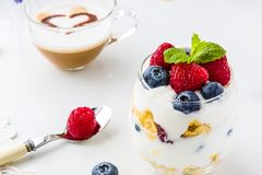 Healthy breakfast full of vitamins and probiotics. Yoghurt, cornflakes and fruit stock photos