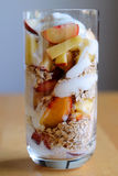 Healthy breakfast in glass. A glass filled with various fruits, oat flakes and plain yogurt Stock Photos