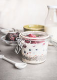 Healthy breakfast in glass jar with yogurt, chia seeds and oatmeal on table Royalty Free Stock Image