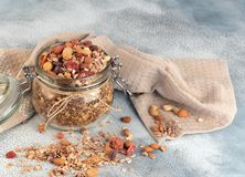 Healthy breakfast - glass jars of oat flakes,granola with dried royalty free stock images