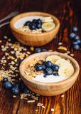 Breakfast with Granola, Banana and Blueberry. Healthy Breakfast with Granola, Banana, Blueberry and Greek Yoghurt. Vertical Orientation royalty free stock photo