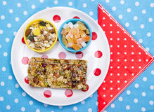 Healthy breakfast. Granola bars, candied fruit, muesli as a healthy breakfast Stock Photography