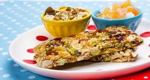Healthy breakfast. Granola bars, candied fruit, muesli as a healthy breakfast Stock Photos