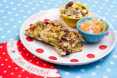 Healthy breakfast. Granola bars, candied fruit, muesli as a healthy breakfast Royalty Free Stock Photos