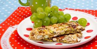 Healthy breakfast. Granola bars, grapes as a healthy breakfast Stock Photos