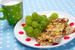 Healthy breakfast. Granola bars, grapes as a healthy breakfast Royalty Free Stock Images