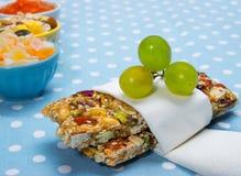 Healthy breakfast. Granola bars, grapes as a healthy breakfast Stock Image