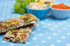 Healthy breakfast. Granola bars, grapes as a healthy breakfast Royalty Free Stock Image