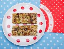 Healthy breakfast. Granola bars on white plate Stock Photos