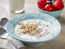 Healthy breakfast granola in a blue plate Royalty Free Stock Photo