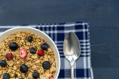 Healthy breakfast granola cereal with blueberries and spoon. Healthy breakfast granola cereal with blueberries and silver spoon Royalty Free Stock Photography