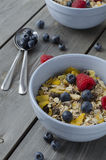 Healthy breakfast. Granola with fresh berries on wooden background, healthy breakfast Royalty Free Stock Photo