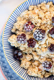 Healthy Breakfast with Granola and Frozen Blackberries Stock Photography