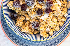 Healthy Breakfast with Granola and Frozen Blackberries Royalty Free Stock Image