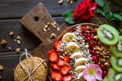 Healthy breakfast with granola, fruit and berries stock photo