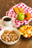 Healthy breakfast with granola, fruits, nuts and coffee. Stock Photography