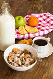 Healthy breakfast with granola, fruits, nuts and milk. Stock Photo