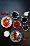 Healthy breakfast with granola, greek yogurt, berries and milk Royalty Free Stock Photo