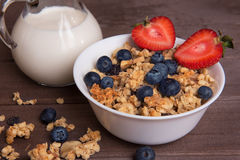 Healthy breakfast. Granola, milk, and blueberries Stock Image