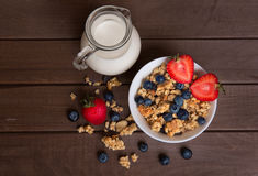 Healthy breakfast. Granola, milk, and blueberries Stock Photo