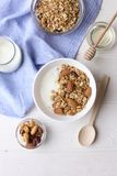 Healthy breakfast granola with nuts on window sill at home. Healthy breakfast on window sill homemade granola with nuts. Healthy granola bars with nuts, seeds Stock Photo