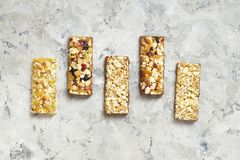 Healthy breakfast granola with nuts on window sill at home. Healthy breakfast on window sill homemade granola with nuts. Healthy granola bars with nuts, seeds Royalty Free Stock Images