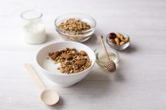 Healthy breakfast granola with nuts on window sill at home. Healthy breakfast on window sill homemade granola with nuts. Healthy granola bars with nuts, seeds Royalty Free Stock Photography