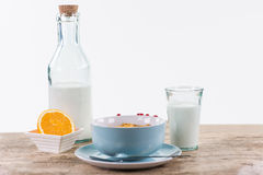 Healthy breakfast with granola, orange fruit and fresh milk Stock Images
