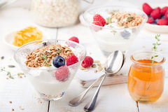 Healthy breakfast. Granola with pumpkin seeds, honey, yogurt, fresh berries . Stock Photo