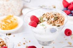 Healthy breakfast. Granola with pumpkin seeds, honey, yogurt, fresh berries . Royalty Free Stock Photography