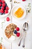 Healthy breakfast. Granola with pumpkin seeds, honey, yogurt, fresh berries . Stock Images