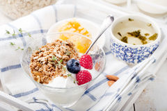 Healthy breakfast. Granola with pumpkin seeds, honey, yogurt, fresh berries . Stock Photography