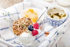 Healthy breakfast. Granola with pumpkin seeds, honey, yogurt, fresh berries . Stock Photography
