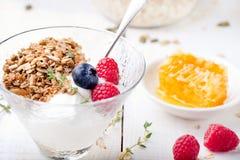 Healthy breakfast. Granola with pumpkin seeds, honey, yogurt, fresh berries . Royalty Free Stock Photo