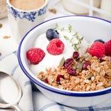 Healthy breakfast. Granola with pumpkin seeds, honey, yogurt ,fresh berries. Royalty Free Stock Photo