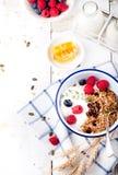 Healthy breakfast. Granola with pumpkin seeds, honey, yogurt ,fresh berries. Stock Images