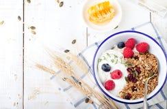 Healthy breakfast. Granola with pumpkin seeds, honey, yogurt ,fresh berries. Royalty Free Stock Photos