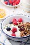 Healthy breakfast. Granola with pumpkin seeds, honey, yogurt ,fresh berries. Stock Photos