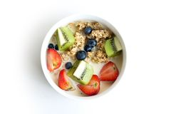 Bowl of Granola with fresh fruits royalty free stock images