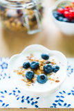 Healthy breakfast with granola, yogurt and fresh fruits Stock Photos