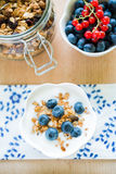 Healthy breakfast with granola, yogurt and fresh fruits Stock Image