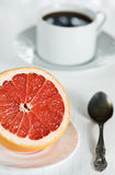Healthy breakfast with grapefruit and coffee Royalty Free Stock Images