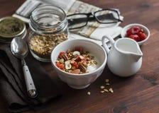 Healthy Breakfast - Greek yogurt and homemade granola on a dark wooden surface. stock photos