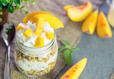 Greek yogurt with granola and peach Stock Photos