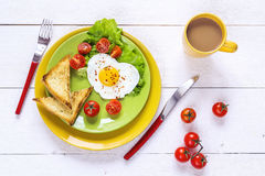 Healthy Breakfast with heart-shaped fried egg, toast, cherry tom Royalty Free Stock Images
